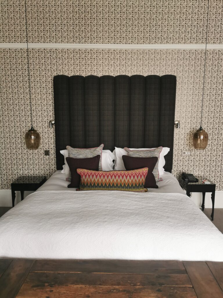 One of the main house bedrooms in Rosehip wallpaper